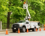 Expand photo of TM3 crew member working on street light
