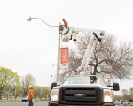 Expand photo of TM3 crew installing LED fixtures on street light